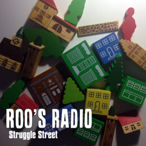Cover art for Struggle Street by Roo's Radio (children's toys on a white background harshly lit from the side)